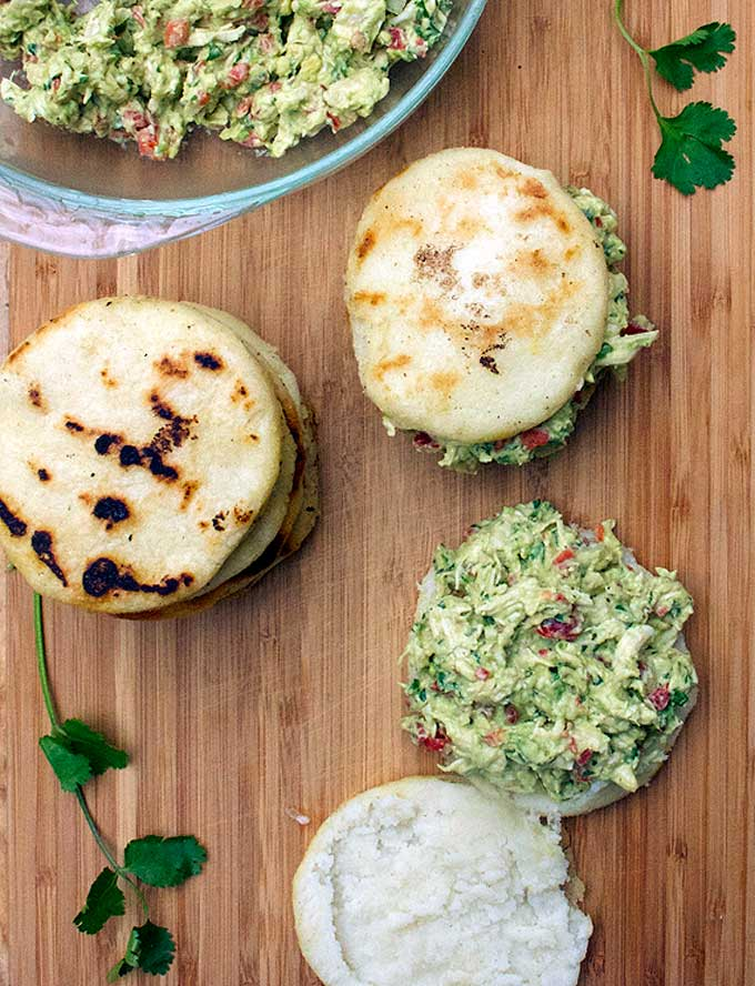 Venezuelan arepas stuffed with avocado chicken salad