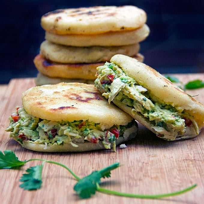 Arepas are gluten free corncakes, eaten in Venezuela in place of bread - crunchy outside, tender inside, filled with chicken or cheese or anything you like. This recipe pairs homemade arepas with scrumptious Venezuelan chicken and avocado salad.