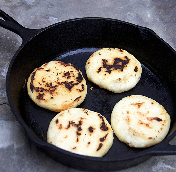 searing arepas in a skillet