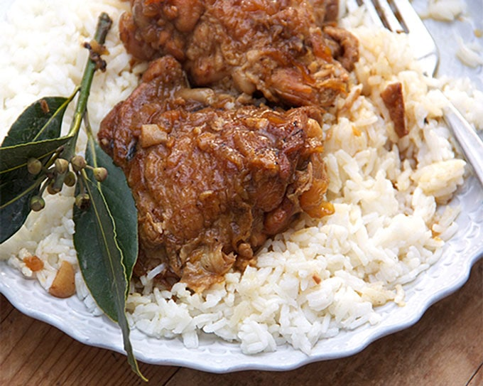 Filipino Chicken Adobo: Tender falling-apart chicken in a tangy, vinegary garlic sauce. Delicious served over rice.