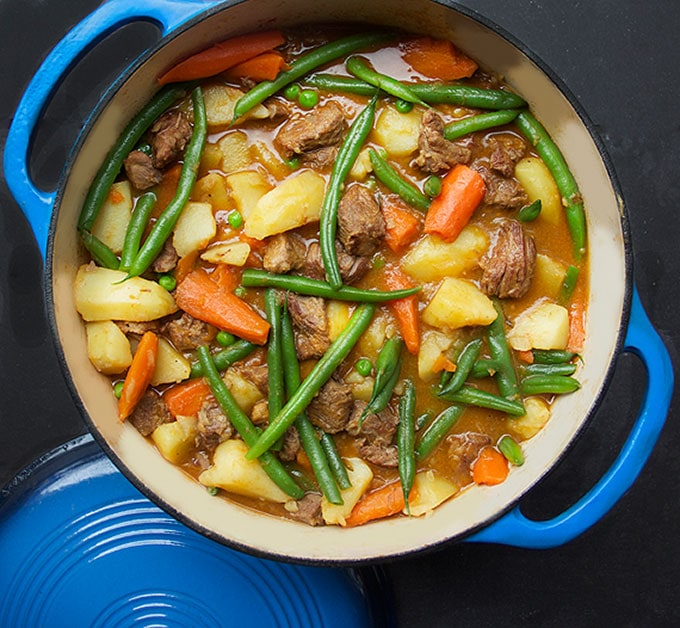 Here's a recipe for perfect lamb stew with fresh healthy spring vegetables - a wonderful one pot dinner that's worthy of any occasion. Extremely tender lamb in a delicious savory sauce with bright spring vegetables. Stew doesn't get any better than this!