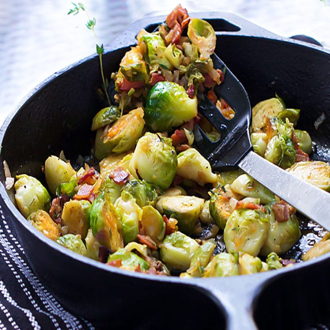 Skillet brussels sprouts: browned and caramelized with bacon, shallots & sherry vinaigrette. Super flavorful! This side dish is definitely worthy of a special occasion.