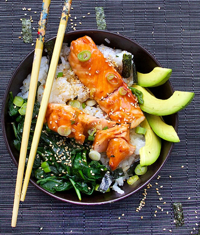 Teriyaki Salmon Rice Bowl with Spinach and Avocado and Sesame-Nori Confetti and chopsticks