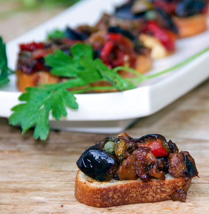 Caponata is a Sicilian Sweet and Sour Eggplant Relish that makes a fantastic topping for bruschetta. It's also great with simple grilled or broiled fish or chicken, or as a sauce for pasta. {vegan, gluten-free}
