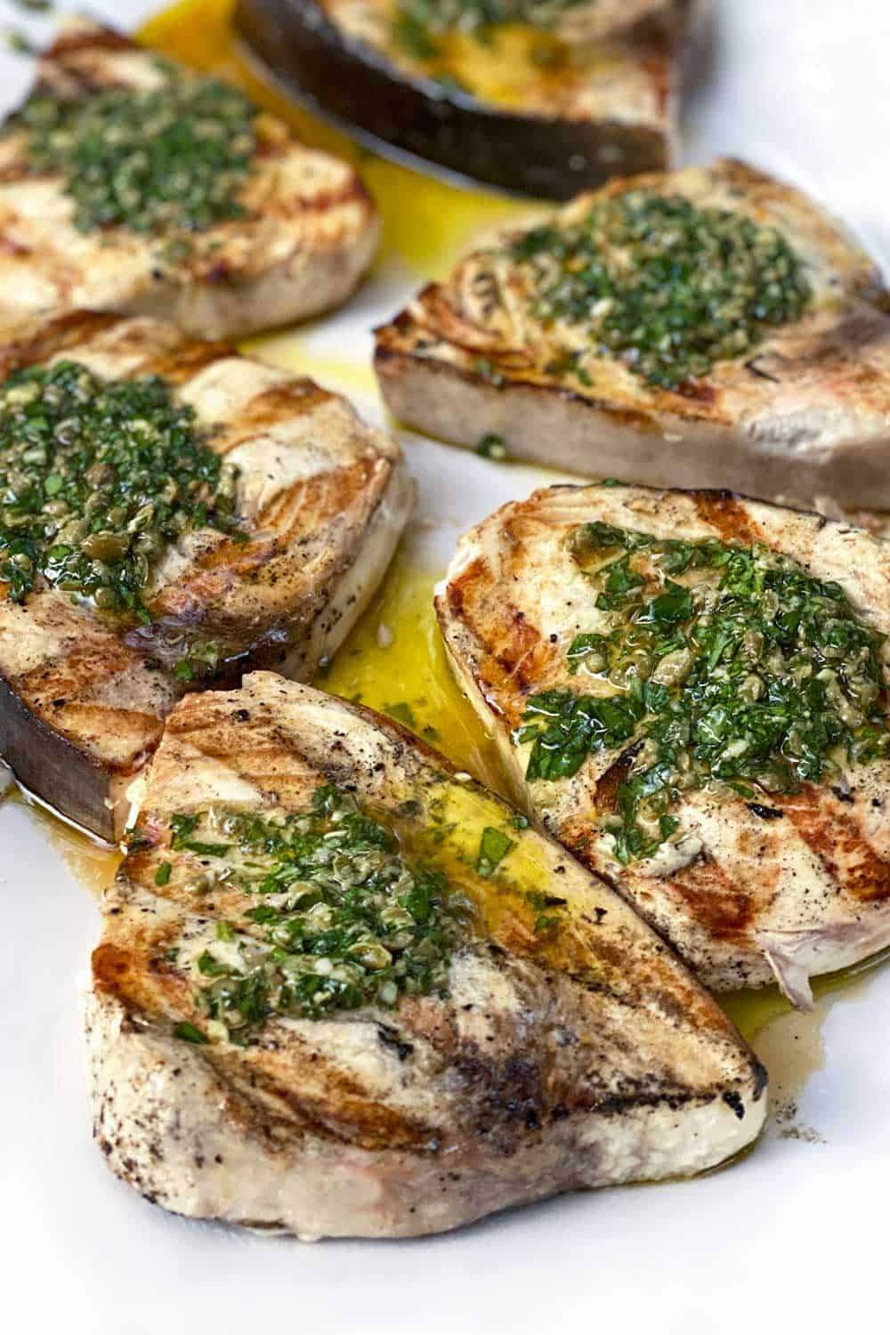 5 grilled swordfish steaks topped with green salsa verde