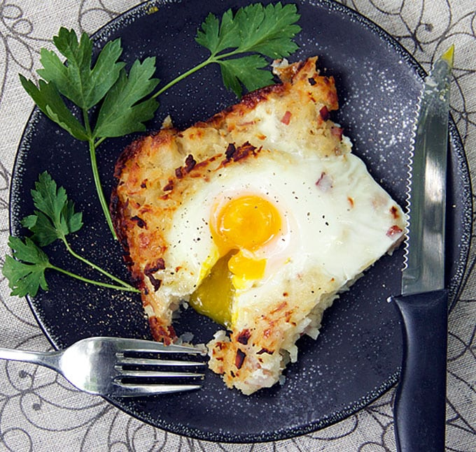 Rösti is a Swiss shredded potato casserole with ham, onions and cheese melted in, and soft-cooked eggs baked on top. It's the perfect brunch recipe. Plus, you can do most of the prep ahead of time.