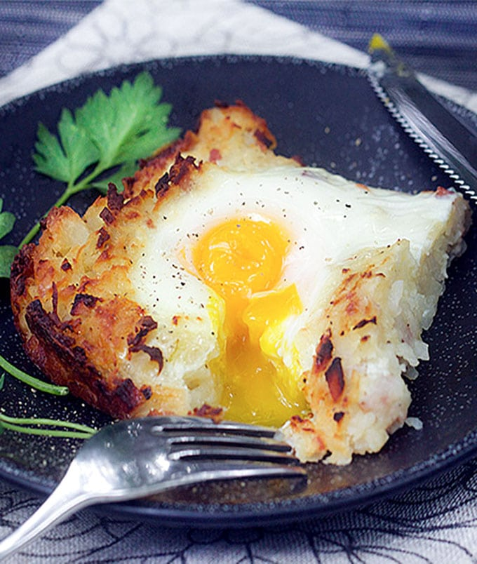 Swiss Rosti is a shredded potato casserole with ham, onions and cheese melted in, and soft-cooked eggs baked on top. It's the perfect brunch recipe, and you can do most of the prep ahead of time.