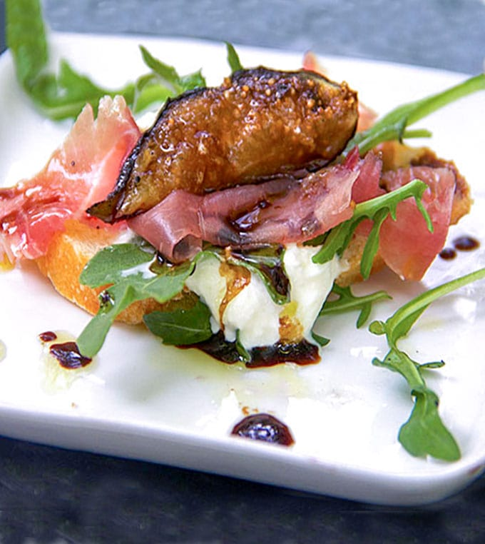 Here's an easy appetizer that's elegant and delicious: Grilled Figs, Proscuitto and Burrata