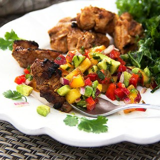 Spicy Mexican grilled chicken with nectarine salsa is the perfect summer dinner. The spicy chicken flavors contrast deliciously with the fruity tangy salsa of nectarines, bell peppers, avocado and lime juice. Hands-on time for this recipe is very little. Let the chicken marinate for an hour or two. Thread it onto skewers and grill. Top with tangy nectarine salsa and you're in for a big treat!