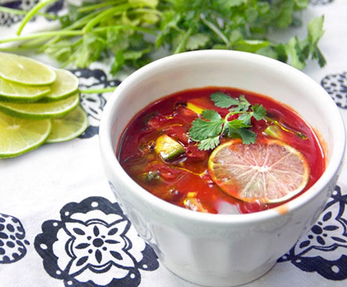 Spiced up tomato juice with cubed avocado, cilantro, garlic and lime juice makes the BEST quick and easy gazpacho! This delicious cold tomato soup is ready in 15 minutes. Ladle it into bowls and garnish with a generous drizzle of extra virgin olive oil and a thin slice of fresh lime.