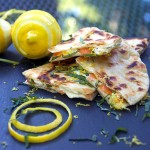 These Smoked Salmon Quesadillas are a fantastic brunch recipe that's easy to prep ahead and is a huge crowd pleaser. Crisp tortillas filled with smokey salmon, creamy tangy goat cheese, lemon zest and slivered basil.