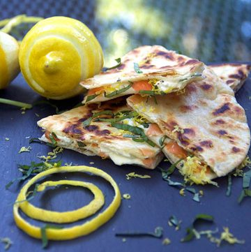 These Smoked Salmon Quesadillas are a fantastic brunch recipe that's easy to prep ahead, and they're a huge crowd pleaser. Crisp tortillas filled with smokey salmon, creamy tangy goat cheese, lemon zest and slivered basil.