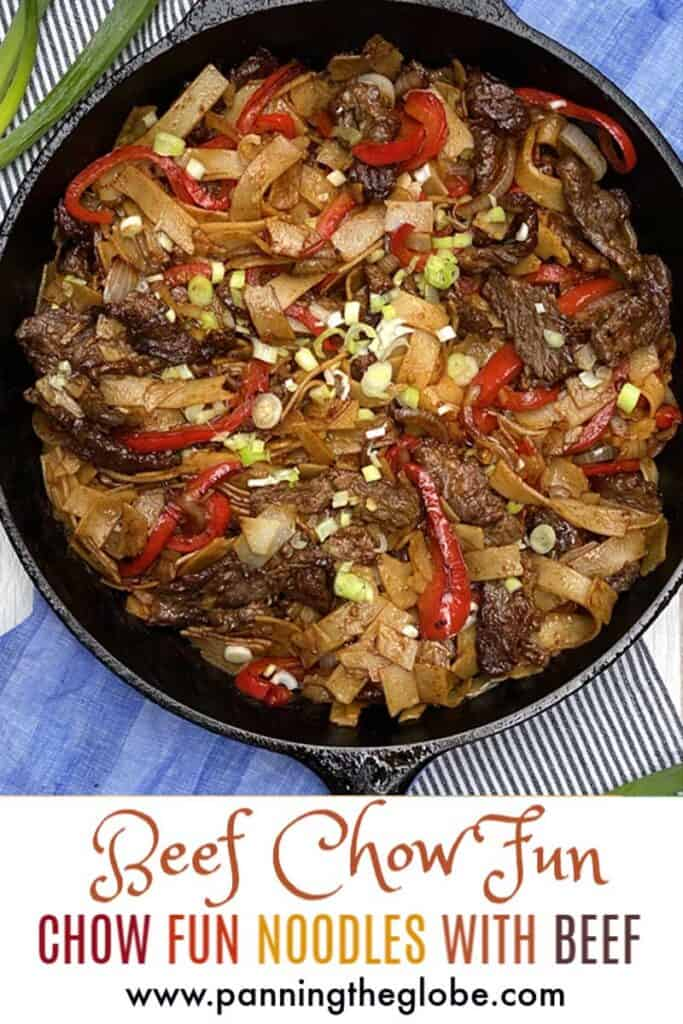 Beef chow fun noodles in a cast iron pan