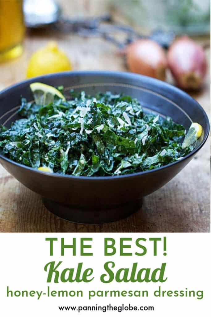 shredded kale salad in a black bowl