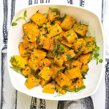 cubes of roasted butternut squash in a white bowl