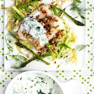 Fresh haddock fillets are baked an a bed of shredded vegetables and topped with delicious lemon almond gremolata l www.panningtheglobe.com