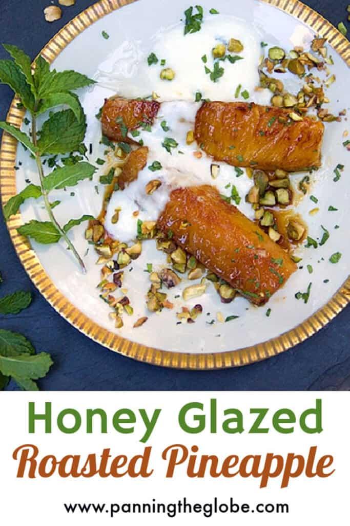 pinterest pin: honey glazed roasted pineapple with yogurt and chopped pistachios