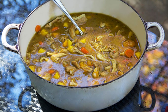 A pot of Jamaican Curried Chicken Stew with Rum and Mango