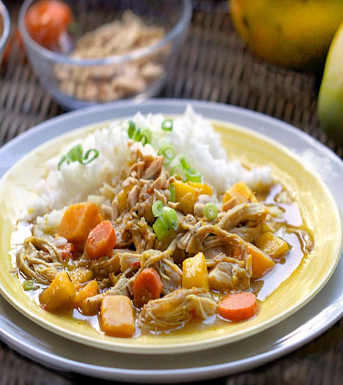 This delicious Jamaican Curried Chicken Stew has tender shredded chicken and cubes of butternut squash simmered in coconut curry broth, with rum and mango. It tastes like the Caribbean!