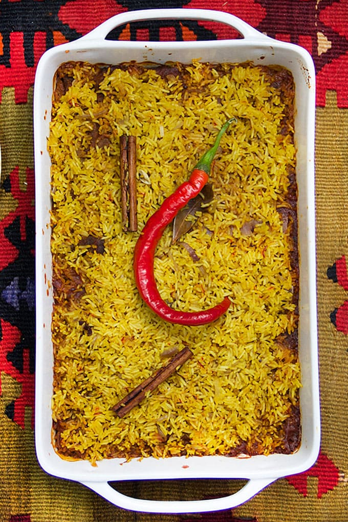 Indian Lamb Biryani is a casserole of tender lamb curry and fragrant saffron rice. Two outstanding dishes combined into one company worthy casserole. Serve with cooling cucumber raita on the side.