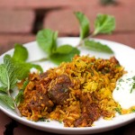 Indian Lamb Biryani: Sumptuous casserole of tender lamb curry with saffron spiced rice with cucumber-mint raita on the side|Panning The Globe