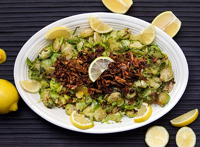There's tons of flavor in these pan browned Shredded Brussels Sprouts with Crispy Fried Shallots - a fantastic side dish recipe for a special occasion l www.panningtheglobe.com
