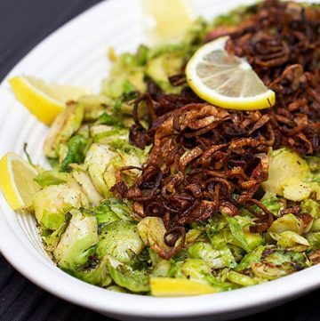 There's tons of flavor in these pan-browned shredded brussels sprouts with Crispy Fried Shallots - a fantastic side dish recipe for a special occasion l www.panningtheglobe.com