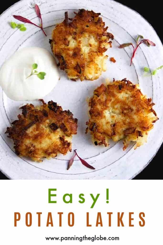 Pinterest pin: 3 latkes on a plate with sour cream