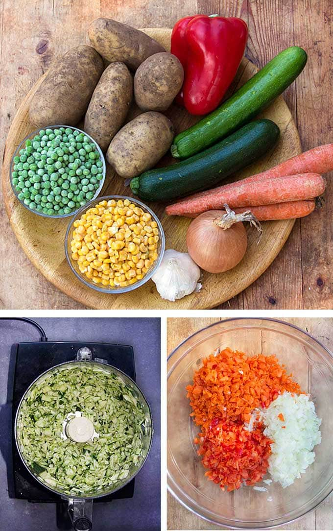 a round wooden tray with raw veggies for healthy shepherd's pie: potatoes, zucchini, carrots, onion, garlic, peas and corn and showing how to chop the zucchini, carrots, onions and peppers in a food processor.