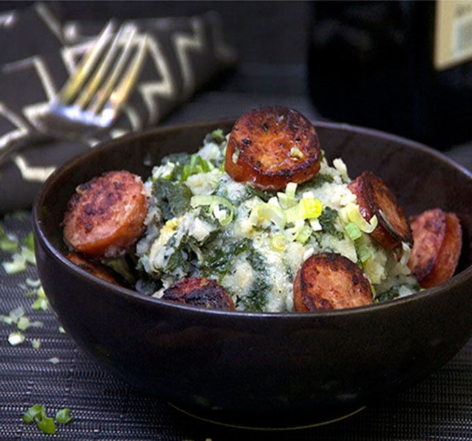 Dutch Stamppot is comfort food of the Netherlands. Kale mashed potatoes, topped with smoky sausages. A perfect hearty fall or winter meal.