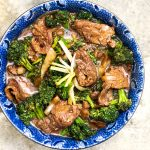 It's easy to make the most delicious Chinese Beef and Broccoli stir fry at home, lighter and healthier than takeout. Tender beef, crisp-tender broccoli, delicious sauce. Serve with fluffy white rice l Panning The Globe recipe