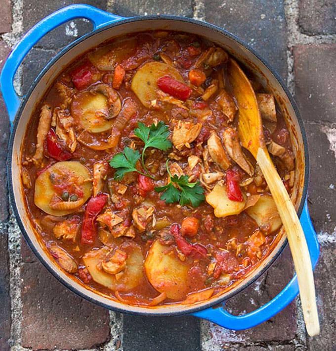 Chicken Cacciatore with Roasted Vegetables and Potatoes: a new take on Chicken Cacciatore, a rustic stew of tender boneless chicken, simmered with wine, tomatoes, carrots, mushrooms, roasted peppers and potatoes.