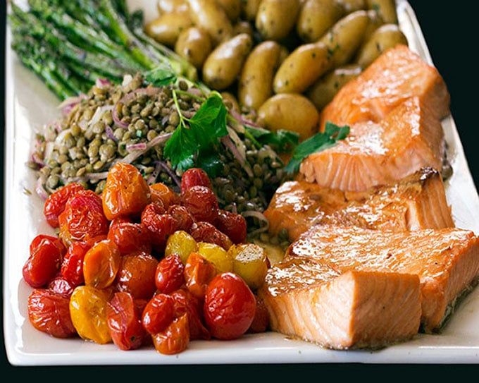This Salmon Niçoise Salad has perfectly cooked salmon, lentils, potatoes, asparagus, and roasted tomatoes.