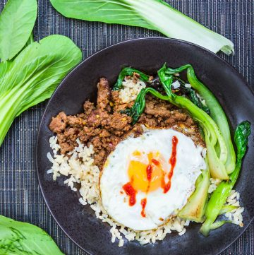 It takes just 20 minutes to make this super flavorful, healthy dinner recipe: Thai Beef Bok Choy Rice Bowl with an egg on top. Add your favorite hot sauce!