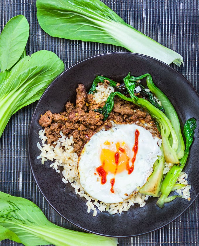 Thai Beef Bok Choy Rice Bowl with an egg on top. YUM! A quick and delicious dinner in 20 minutes l www.panningtheglobe.com