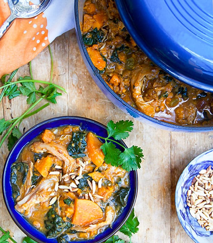 This Moroccan Chicken Stew is a one-pot dinner with fall-apart tender chicken thighs, sweet potatoes, dried apricots and kale, oven-braised in chicken broth and aromatic spices. [paleo] [gluten-free, dairy-free] l panningtheglobe.com