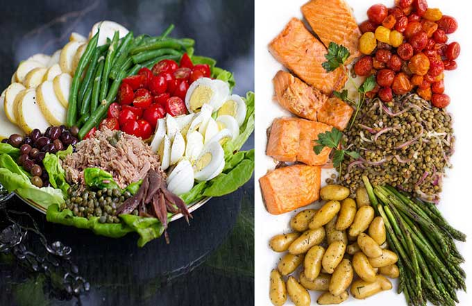 Two composed salads: Salad nicoise with tuna, eggs, tomatoes, green beans, potatoes and olive, and fusion salmon nicoise with roasted salmon, potatoes, asparagus, lentils and roasted tomatoes
