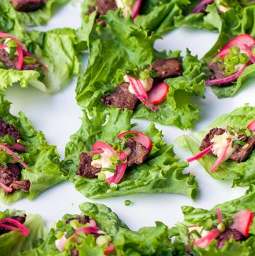 These Korean Beef Lettuce Wraps are fantastically flavorful. Pan seared beef tenderloin in scrumptious Bulgogi marinade, wrapped up in lettuce leaves with homemade picked onions and radishes and miso mayonnaise. Serve as an appetizer or main dish.