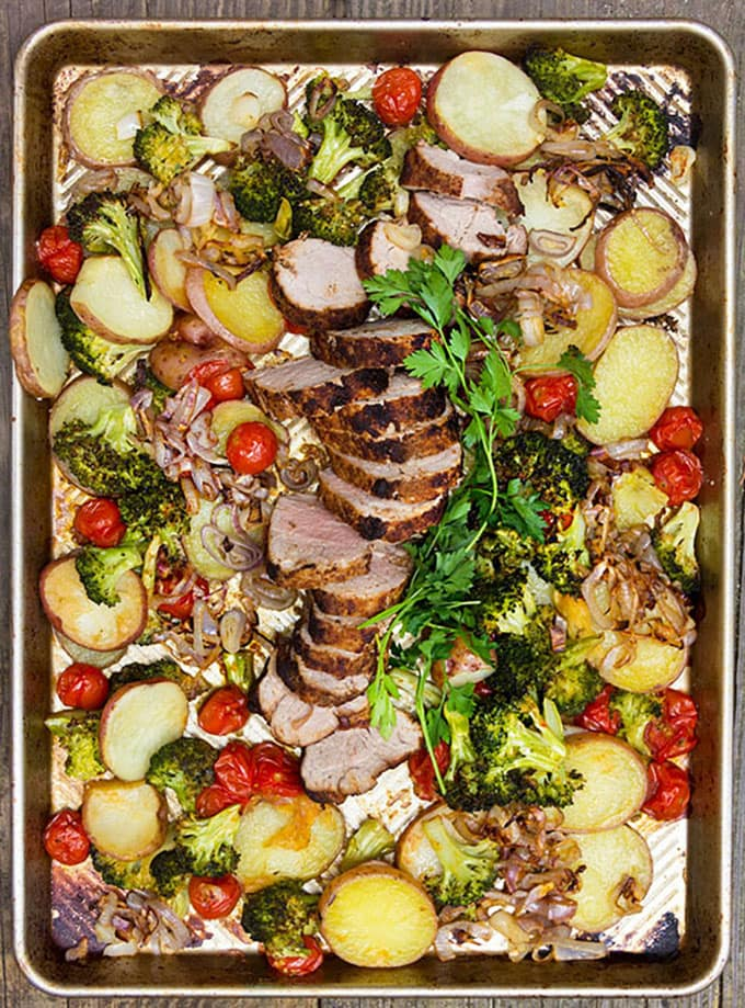 Get out your sheet pan for this quick delicious spice crusted pork with potatoes and vegetables from Panning The Globe