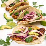 Blackened Fish Tacos with Cabbage, Avocado and  jalapeño Cilantro Sauce