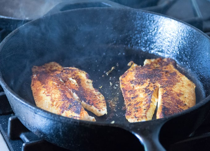 blackened fish in a skillet