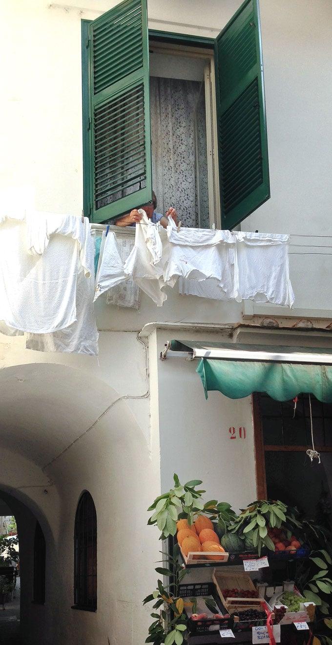 woman hanging wash in Amalfi