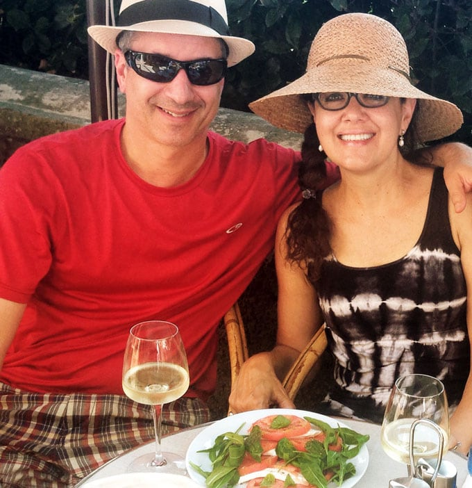 Ed and Lisa Goldfinger sitting at a restaurant on the Isle of Capri, eating a caprese salad and drinking white wine