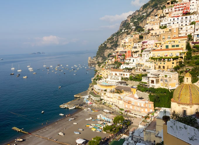 Beautiful landscape photo of Positano, Italy, with ocean and a mountainside of pastel buildings