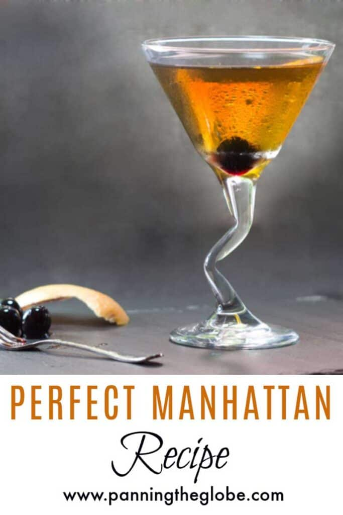 martini glass with a zig zag stem, filled with a perfect manhattan cocktail