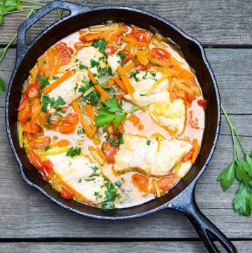 Fish in crazy water is a classic Neopolitan dish of fresh fish, poached with carrots, celery, onions and tomatoes. The fish is tender, the veggies are crisp-tender, the broth is sweet and delicious, and dinner is on the table in just 30 minutes.