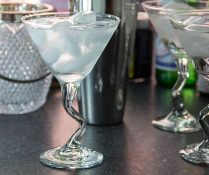 martini glasses are chilled with ice water