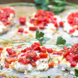 I discovered this delicious chicken pizzaiola recipe in Positano Italy. Chicken dinner doesn't get any easier than this. 15 minutes of prep, 13 minutes in the oven. Tender chicken cutlets with fresh tomatoes, herbs and melting cheeses l www.panningtheglobe.com