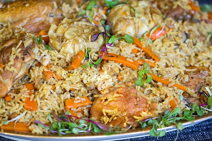 Chicken Plov: a scrumptious chicken and rice casserole recipe from Uzbekistan, with lots of carrots, onions, herbs and delicious spices l www.panningtheglobe.com