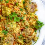 close up of a platter of chicken plov, chicken and rice casserole